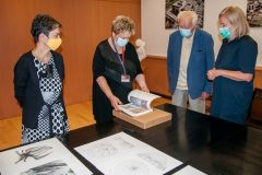 """Head of the NSK Print Collection Tamara Ilić-Olujić, Director General of the National and University Library in Zagreb (NSK) Dr Ivanka Stričević, Head of the Croatian Museum of Architecture and Fellow of the Croatian Academy of Sciences and Arts Andrija Mutnjaković and the Museum's Director Dr Borka Bobovec at the takeover of the portfolio """"Kinetic architecture 1964-1990"""" (Mutnjaković, A., Zagreb: Hrvatska akademija znanosti i umjetnosti, 2021). National and University Library in Zagreb, 15 September 2021."""