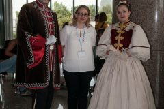Chair of the Local Organising Committee Dr Dijana Machala with actors costumed as distinguished figures who marked the history of Zagreb, the capital of Croatia, at a special programme accompanying IFLA CPDWL preconference announcing IFLA WLIC 2019. National and University Library in Zagreb, 21 August 2019.