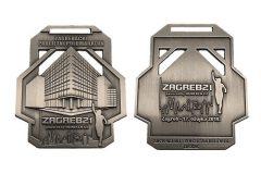 Dizajn dodijeljenih medalja s detaljem Nacionalne i sveučilišne knjižnice u Zagrebu.