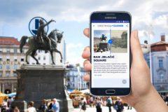 """Pretisci razglednica s motivima zagrebačkih lokacija preko QR kôda vode na nagrađivanu mobilnu aplikaciju NSK """"Pozdrav iz Zagreba""""."""
