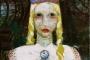 "Jānis Ferdinands Tīdemanis. ""Djevojka u narodnoj nošnji"" (1930.). Latvijski nacionalni muzej umjetnosti. Izvor: http://www.europeana.eu/portal/en/exhibitions/faces-of-europe/."